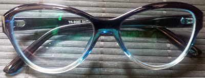 Blue tinted cats eyeglasses folded