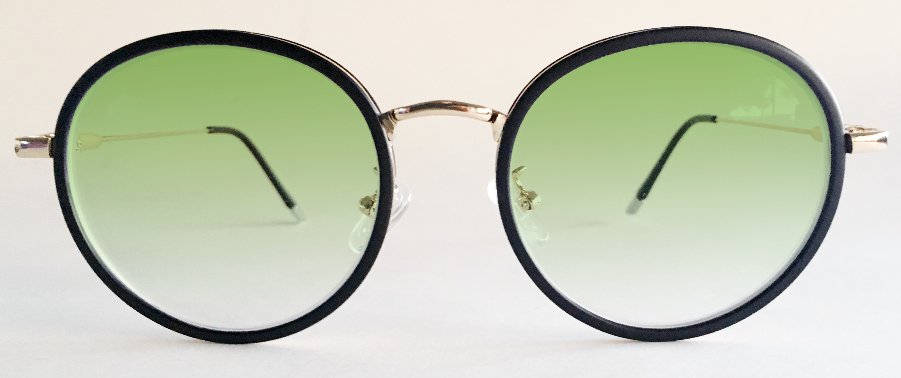 Green tinted round glasses